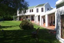 Goose Green Lodge / Goose Green Lodge, one of the oldest guest establishments in the tranquil Noordhoek Valley, offers awe-inspiring views of the mountains and is in close proximity to one of the most beautiful beaches in South Africa. For warm summer afternoons a pool and a traditional braai area in an established Cape garden offers convivial outside relaxation, but also contains a shady gazebo and lots of comfortable garden furniture for enjoying some quiet moments.