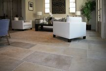 Newport Highwater / Dalle de France Monceau stone flooring, La Terre tiles, and Antique limestone fireplace.