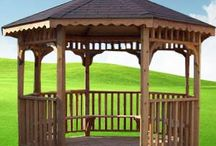 Gazebos / Bunce Buildings' gazebos come in a variety of shapes and sizes starting at 8×8 to 14x40. Some designs can be built to almost any size. We build both the traditional octagonal style and NOW OFFER a less expensive but just as elegant rectangular gazebo.  Choose between: regular shingles, metal roofs and double roofs, and to enhance your gazebo, additional options are offered including benches, screens and cupolas.
