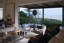 Indigo House / High on the mountainside overlooking Plettenberg Bay lagoon, Indigo House commands a wide, spectacular view. The framework of the interior is white and wood with signature indigo blue in soft furnishings. The house may have the familiar touch of a Caribbean or Miami beach house but the source of the fabric is North African: think wooden dhows, sun-bleached sails and a time when days stretched naturally from dawn to dusk without the constructed rigor of modern times.