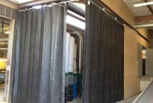 Acoustic Curtains / Acoustic curtains for industrial applications are made using sound reduction, energy absorbing materials that minimize excessive noise in the workplace. Sound barrier curtains and panels reduce noise to safe OSHA limits for worker safety.