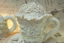 Lace covered cup and saucer