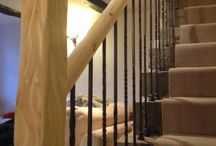 Total room solutions  / This was a very old farm house and the original spindles where pine and didn't suit the style of the house so we removed them and installed new cast iron spindles new handrail and distressed the newel post