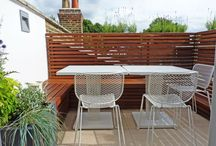 Parsons Green by Really Nice Gardens / We designed this tiny Parsons Green roof terrace to be a bright and secluded space, with room for a BBQ, benches and a few planters.