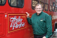 Ms. Trolley Parton / Puckett's Trolley is a food truck eatery—affectionately nicknamed Ms. Trolley Parton by her fans—that offers made-to-order bites from a renovated and historic mobile venue. All of Ms. Parton's food comes with the special Puckett's stamp, though some of her dishes are signature items!