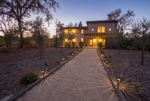 1912 Mora Avenue, Calistoga, CA / 1912 Mora Ave, Calistoga, CA 94515  Tuscan inspired wine country estate on nearly 1/2 acre. One of a kind home with reclaimed antique solid oak flooring, custom cabinets, granite & marble in kitchen & baths, 7 french doors, 2 upstairs balconies, private courtyard w/ outdoor kitchen & vineyard views. City water & sewer, full solar system, rural, quiet setting yet only 1 Mi from downtown Calistoga. 2017 built detached 600 sq ft garage with bonus space above. Large, useable backyard.