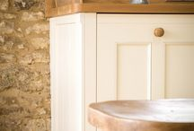 A Traditional Country Kitchen / At a glance it looks like a kitchen from almost any era but with a touch of the super modern, this spacious bespoke kitchen uses subtle mouldings and embellishments to achieve that classic country feel, perfectly at home in this ancient barn setting.