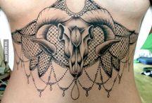 Tattoos underboobs/mandala/hamsa