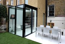 Project: Camberwell / A small glass box extension to Grade II listed terrace house project in London. Includes slim framed sliding glass doors, back panted glass and structural glazing.