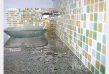 Susan Jablon Bathroom Tile Ideas / Think beyond a backsplash behind your bathroom sink. Mosaic glass tiles can be used to cover an entire wall, shower surround, floor, or as an accent in your space!