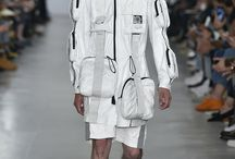 """SS17 LAUNCH Catwalk / This season Christopher Raeburn contrasts the vision of a terrestrial dystopian future as portrayed in George Lucas' film debut, """"THX 1138"""" with the hope and momentum of the early years of the Race for Space. The collection brings both menswear and womenswear together to travel a valiant journey from launch, capsule, extra-vehicular activity and touch down, drawing inspiration from both pioneering construction and idealistic stargazing."""