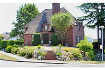 All Brick Lionel Pries French Normandy Design / A Lionel Pries French Norman designed all brick home. Several gorgeous Puget Sound, Alki Point & Olympic Mountain views. On the open market for the first time ever! You could be only the third owner of this stately Carlton Park view home. Impressive corner lot home has been lovingly maintained & remodeled. Features beautiful hardwood floors, open beam ceilings, circular stair case & 2 car garage. One gas fireplace in the sun lit living room & a wood fireplace in the downstairs den. $1,150,000.