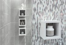Modern Metro / This look is suitable for people who are inspired by an urban lifestyle. Use fifty shades of grey in your tile selection - cement look tiles are very popular at the moment - and add a pop of colour to create a sleek yet sophisticated atmosphere. Modern accessories like taps and showerheads could be used as statement pieces to complete the look
