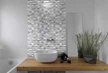 Explore Cities / Waxman Ceramics is pleased to reveal a new mosaic range that is sure to unleash the hidden explorer in even the biggest homebody. With an urban style and contemporary colour scheme, Cities incorporates texture with colour and reveals names of cities across the world on subtly embossed, randomly placed tiles.