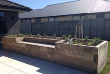 raised garden beds/planter boxes / This is a selection of gardens with railway sleepers, found on the internet. Deresch Landscaping is/was NOT involved in any of these projects.
