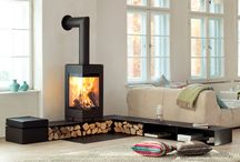 Two sided wood stove design / Looking for a hearth for my two sided wood stove that you can sit on but also breaks the space between the living room and the kitchen