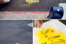 Spray paint a phrase on the ground with chalk spray!