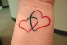 tattoos / by Erin Gerth
