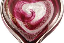 "Giant Heart Memorials / Our Giant Hearts are a beautiful combination of dichroic glass made from precious metals, specially formulated glass color and the ashes of your loved one. The heart is handmade in our studio in Seattle by a team of artisans who have created 12,000 memorials with care and diligence. The heart is approximately 5½"" x 5"" and weighs about 1 lb 10 oz. The feel of this heart in your hands gives a feeling of connection and comfort."