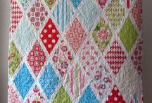 Quiltings:Of Love / Quilts...sooo many choices....sooooo little time.  Everyone should sleep under a quilt that someone made for them, with love.  Here are some quilts that others have made.  They are inspiring and beautiful. / by Penny Spinster