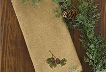 Pattern: Burlap & Pine / Decorate your kitchen with country holiday style! Our popular soft cotton burlap collection has been updated with hand embroidered pine boughs and pinecones, so striking for the holidays or anytime of year! / by Piper Classics