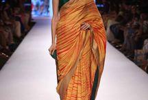 Mandira Bedi | Lakme Fashion Week S/R'15 / Straight off the runway! Bold Banarasi saris in bright hues.