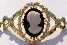 Cameo Jewelry /  In fine jewelry, the cameo is defined as an ornament carved in relief from a high-quality material such as stone, shell, coral, Gutta-percha, bog oak, ivory, lava, or mother-of-pearl. In costume jewelry, cameos are generally made from molded plastic or glass.  The most common cameo motif is the portrait.  / by Amethyst Cheairs