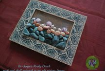 Between a Rock and an Art Place / Re-Scape owner Brenda Ellison's own rock, stone, slate and pebble creations as art work.