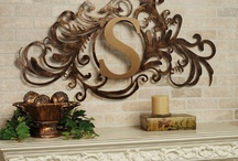 Monogram Wall Grilles / Reflect your family name and your good taste with a monogram wall grille. These metal accents may be displayed indoors or outdoors and feature an initial surrounded by scrolls and classic flourishes.