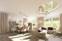 Wystrój wnętrz eleganckiego salonu połączonego z jadalnią - Tissu. / Luksusowe, przestronne wnętrze utrzymane jest w jasnych barwach, ożywionych lustrami na suficie.