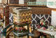 Department 56 - Christmas in the City / Open the door to the hustle and bustle of city living. This series of hand-painted porcelain buildings and accessories captures the elegance and excitement of the city.