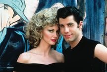 1950S HIGH SCHOOL STYLE: 'GREASE' FASHION / Released in 1978, the film was set in the 1950s (1959 to be exact) and followed the story of Sandy Olsson and Danny Zuko–played by Olivia Newton John and John Travolta– who are two teenagers who fell in love over the summer, and rekindle their romance. Travolta plays a leather jacket wearing greaser while Sandy embraces more preppy style with cardigans and full skirts. The movie is full of amazing costumes and hairstyles that celebrate 1950s fashion to the fullest.