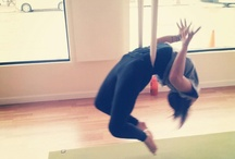 """Antigravity Yoga / Get ready to """"get vertical"""" in this fusion technique that is often seen as a bridge between fitness and traditional yoga modalities. AntiGravity provides a exhilarating workout while hanging out (pun intended), releasing the spine – and mind – in zero compression inversions!"""