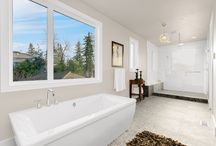 Rub-A-Dub-Dub / Relax with a good book (or Netflix) in these gorgeous master and secondary bathrooms.