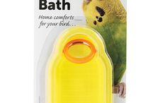 Bath & Misters for Parrots & Birds / Parrots regularly have baths in the wild and it is important that pet parrots & birds can have baths too. This is important for keeping their feathers in good condition but it does add a an element of fun tooy.
