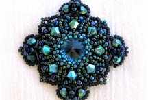 Beaded pendants and brooches / by Diana Rehfield