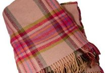 Wrapped in Wooly Warmth / Luxurious home goods made in Ireland truly are arts of work!  Soft, colorful, and so very warm.  Great for throws in the livingroom, blankets in the bedroom, or we have ones that are perfect for outdoor games & picnic blankets!  Make amazing wedding gifts that will be treasured for years!