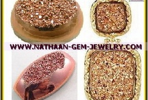 Rose Gold Titanium Coated Flat Drusy and Window Druzy Gemstones For Jewelry / Extremely Beautiful AAA Titanium Coated Rose Gold Coated Drusy and Window Druzy Stones, these titanium-coated quartz stones sparkle with deep Rose Gold, sea blues, magentas, and pinks. Can steals the show when appearing in custom-made designer jewelry. Sources: http://nathaan-gem-jewelry.com/