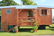 Living wagons / We make wooden wagons in all sizes and layouts, here in Devon using local timber. Our larger wagons are perfect for original, distinctive glamping accommodation, or for use as a (not so) tiny house. we live in one of our structures, complete with shower, bedroom, fully fitted kitchen, dining area and compost loo. It's insulated with Earthwool and we have a Windy Smithy Louis burner. Super toasty in winter, super cool in summer.