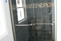 Shower Doors with Headrail- SHOWERMAN /  A headrail is a framed structure that helps to provide support, stability, or act as a design feature for frameless glass shower doors—they come in all styles and beautiful finishes. For sliding glass doors, a headrail is always used to mount over the sliding wheel mechanism.