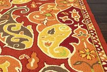 JAIPUR / Beautiful and colorful rugs, throws, poufs and decorative pillows.