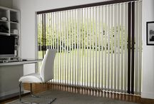 Vertical Blinds / Vertical blinds are available in different forms including: wood, lace, aluminium, rigid and fabric.  Probably the most practical blind type can be used on curved and sloping windows. Vertical blinds offer precise control of sun and light. They can be machine washable and are very versatile. Whether it's classical, modern, comfort or cutting edge design you want, the choice is yours at Bolton Blinds.