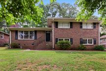 4090 Deerwood Parkway, Smyrna 30082 / Listing Agent: GLENNDA L BAKER; (678) 755-3711; glennda@glennda.net; Run do not walk to this deal of the day in coveted King Springs Elementary school district! Clean and crisp with new paint, granite counter tops, brand new tile back splash (not pictured, it is that new). Open family room with fireplace and hardwood floors. Open kitchen with dining area that opens to entertaining patio and overlooks completely fenced room to play backyard with tree house and well kept outbuilding.