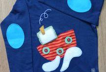 Camisetas / Camisetas decoradas a mano a base de fieltros, telas, botones, piedras sintéticas, lentejuelas...  Diseños coloridos, divertidos y llamativos para los más pequeños de la casa.  Todos lo diseños son susceptibles de hacerse en cualquier tipo de camiseta: manga larga, corta o sin mangas, según la temporada.