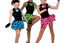 Dance coustums / I'm not a dancer but I used to be for like 7 years dance is so cool but also while I was dancing I did figure skating and now  amazing!!!:);)