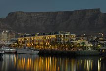 Cape Grace Exterior / Situated on a private quay, nestled between the working harbour of Cape Town's bustling Victoria & Alfred Waterfront and the serenity of an international yacht marina, Cape Grace  showcases the essence of the Cape with designs that reveal local creativity, whilst staying true to the warm atmosphere and personalised levels of service that have for years defined the hotel. #capegrace #hotel #v&awaterfront  / by Cape Grace