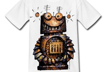 Funny Online T Shirts -StrangeStore Art and Design on SpreadShirt / Paul Stickland Art and Design - StrangeStore on Spreadshirt. Funny cute T shirts and fashion wear for men, women and children. Robots, owls, geeky characters, superape, black cats. Funny T shirts for kids and geeks alike! Geek fashion. Great prices and shipping in Europe and the EU. ADD your own message, slogan or name. TRY IT!