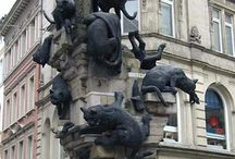 cat sculptures on building