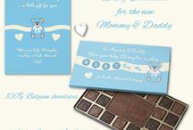 Gifts and gift cards for Mommy & Daddy / Gifts and gift cards for Mommy & Daddy  Spoil the new Mom & Dad on the birth of their baby boy with a box of chocolates. When baby is sleeping they can take a little time for themselves and enjoy these Belgian chocolates.