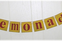 Banners/Garlands / Holiday Banners and Garlands are made out of Wood, Chipboard or Burlap.